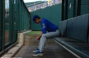 University of Florida pitcher Brady Singer sits alone in the bullpen before his start against the LSU Tigers in the College World Series- Florida Gators baseball- 1280x850