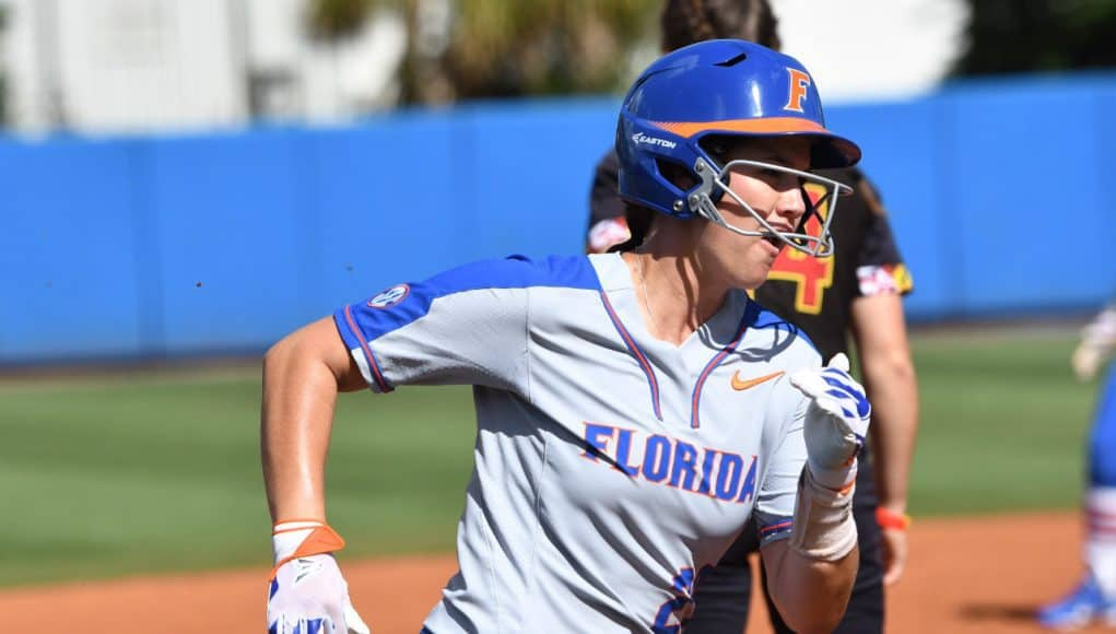 Florida Gators infielder Nicole DeWitt scores against Maryland- 1280x852