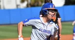 Florida Gators infielder Nicole DeWitt scores against Maryland- 1280x852