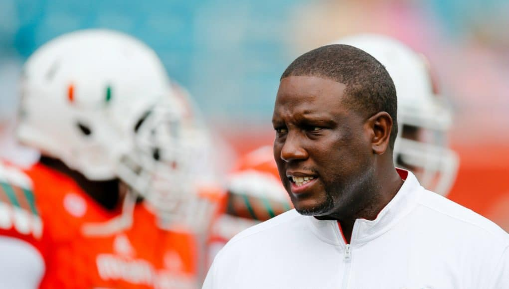 Nov 21, 2015; Miami Gardens, FL, USA; Miami Hurricanes interim head coach Larry Scott talks with his players before a game against the Georgia Tech Yellow Jackets at Sun Life Stadium. Mandatory Credit: Steve Mitchell-USA TODAY Sports