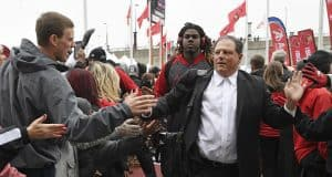 Nov 26, 2016; Louisville, KY, USA; Louisville Cardinals defensive coordinator Todd Grantham greets fans during the Card March before facing the Kentucky Wildcats at Papa John's Cardinal Stadium. Mandatory Credit: Jamie Rhodes-USA TODAY Sports