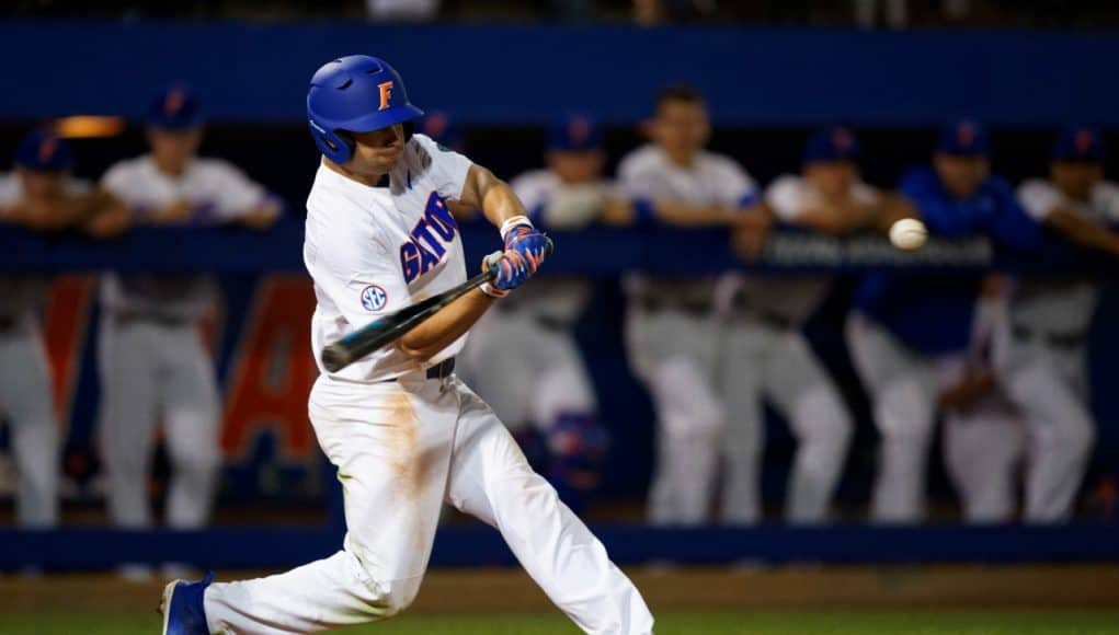 University of Florida outfielder Nick Horvath singles against Siena on opening night of the 2018 baseball season- Florida Gators baseball- 1280x853
