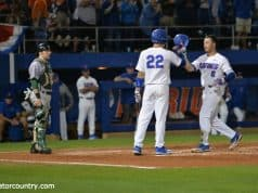 University of Florida third baseman Jonathan India is congratulated by JJ Schwarz after India's fourth inning home run against Siena- Florida Gators baseball- 1280x853