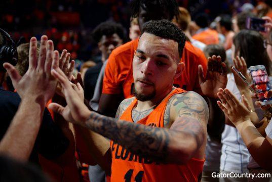 Florida Gators guard Chris Chiozza celebrates after beating Kentucky for senior day-1280x852