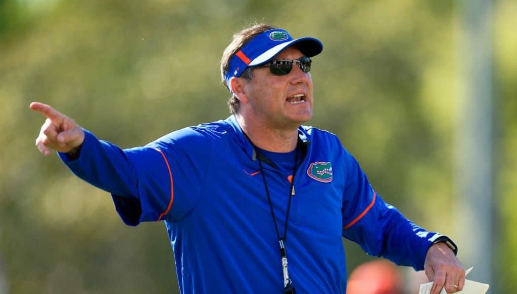 Florida Gators head coach Dan Mullen gives instructions to the quarterbacks- 1280x853