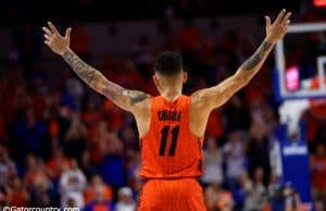 Florida Gators point guard Chris Chiozza recognizes the crowd as he walks off the court during senior day- Florida Gators basketball- 1280x853