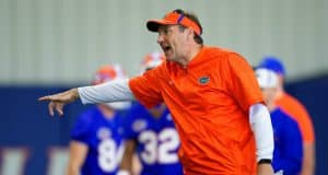 University of Florida head football coach Dan Mullen yells instructions while his football team stretches before football practice begins- Florida Gators baseball- 1280x853