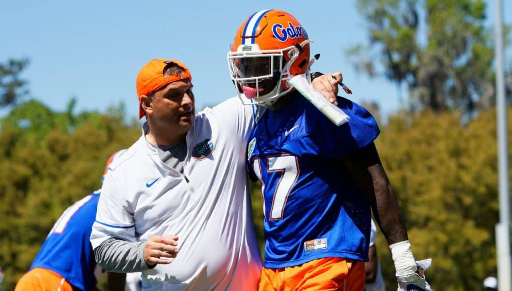 University of Florida receivers coach Billy Gonzales walks with his arm around Kadarius Toney during spring football camp- Florida Gators football- 1280x853
