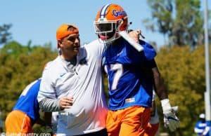 University of Florida receivers coach Billy Gonzales walks with his arm around Kadarius Toney during spring football camp- Florida Gators football- 1280x853