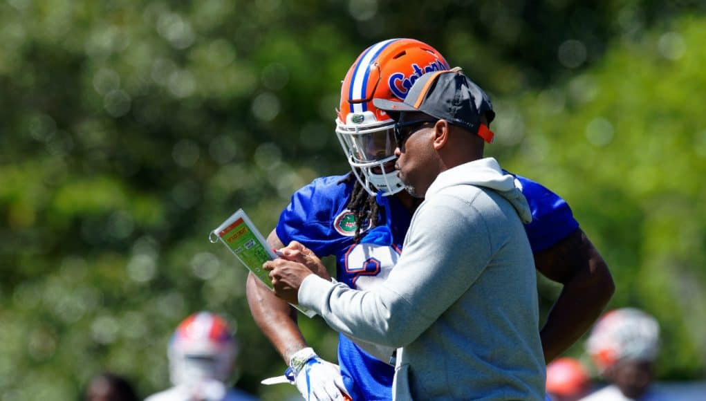 University of Florida running backs coach Greg Knox goes over a play with Jordan Scarlett during the Florida Gators second spring practice- Florida Gators football- 1280x853