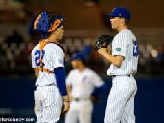 University of Florida pitcher Jack Leftwich and catcher JJ Schwarz meet at the mound in a win over the Florida State Seminoles- Florida Gators baseball- 1280x853