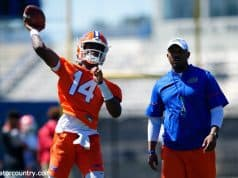 University of Florida quarterback Emory Jones throws a pass while quarterbacks coach Brian Johnson looks on- Florida Gators football- 1280x853