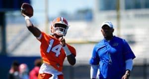 University of Florida quarterback Emory Jones throws a pass while quarterbacks coach Brian Johnson looks on- Florida Gators football- 1280x853
