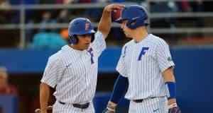 University of Florida seniors Nick Horvath and JJ Schwarz celebrate after Horvath scored a run- Florida Gators baseball- 1280x853
