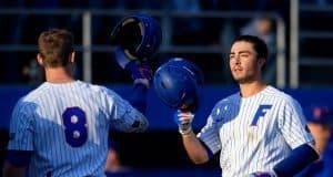 Deacon Liput congratulates University of Florida third baseman Jonathan India after a home run against Florida State- Florida Gators baseball- 1280x853