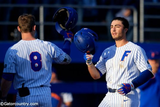 Deacon Liput congratulates University of Florida third baseman Jonathan India after a home run against Florida State- Florida Gators baseball- 1280x853