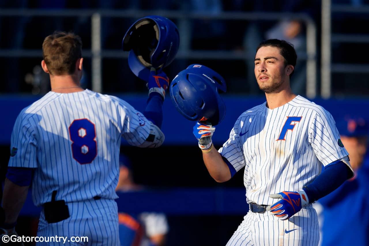 Deacon-liput-congratulates-university-of-florida-third-baseman-jonathan-india-after-a-home-run-against-florida-state-florida-gators-baseball-1280x853