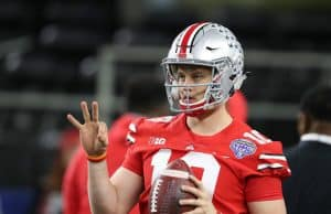 Dec 29, 2017; Arlington, TX, USA; Ohio State Buckeyes quarterback Joe Burrow (10) throws prior to the game against the Southern California Trojans in the 2017 Cotton Bowl at AT&T Stadium. Mandatory Credit: Matthew Emmons-USA TODAY Sports