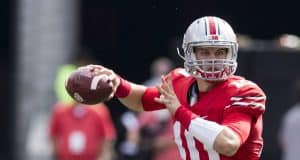 Oct 1, 2016; Columbus, OH, USA; Ohio State Buckeyes quarterback Joe Burrow (10) looks for an open receiver during the third quarter against the Rutgers Scarlet Knights at Ohio Stadium. Ohio State won the game 58-0. Mandatory Credit: Greg Bartram-USA TODAY Sports