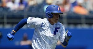 University of Florida catcher JJ Schwarz runs to first base during a win over the Florida State Seminoles- Florida Gators baseball- 1280x853