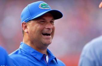 University of Florida co-offensive coordinator Billy Gonzales laughing on the field prior to the Florida Gators 2018 spring game- Florida Gators football- 1280x853
