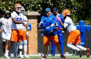 University of Florida defensive coordinator Todd Grantham goes through drills with the Gators defensive ends during spring camp- Florida Gators football- 1820x853