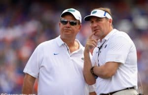 University of Florida defensive line coach Sal Sunseri confers with head coach Dan Mullen during the 2018 Orange and Blue game- Florida Gators football- 1280x853