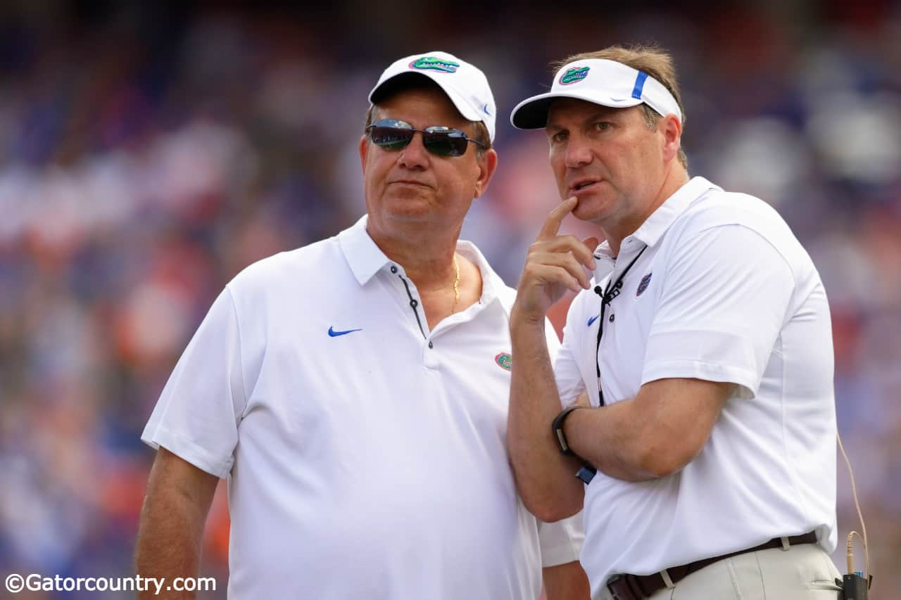 University-of-florida-defensive-line-coach-sal-sunseri-confers-with-head-coach-dan-mullen-during-the-2018-orange-and-blue-game-florida-gators-football-1280x853-