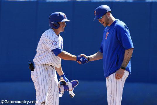 University of Florida infielder Blake Reese shakes Lars Davis' hand after a single against Auburn- Florida Gators baseball- 1280x853