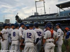 The Florida Gators huddle up before taking infield/outfield leading into their 2018 College World Series matchup with Texas Tech- Florida Gators baseball- 1280x850