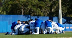 The University of Florida Gators baseball team says a group prayer before their game against the Florida State Seminoles- Florida Gators baseball- 1280x853