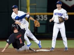 Jun 17, 2018; Omaha, NE, USA; Texas Tech Red Raiders center fielder Cody Farhat (1) slides into second base as Florida Gators second baseman Blake Reese (12) completes a double play with shortstop Deacon Liput (8) watching in the third inning during the College World Series at TD Ameritrade Park. Mandatory Credit: Steven Branscombe-USA TODAY Sports