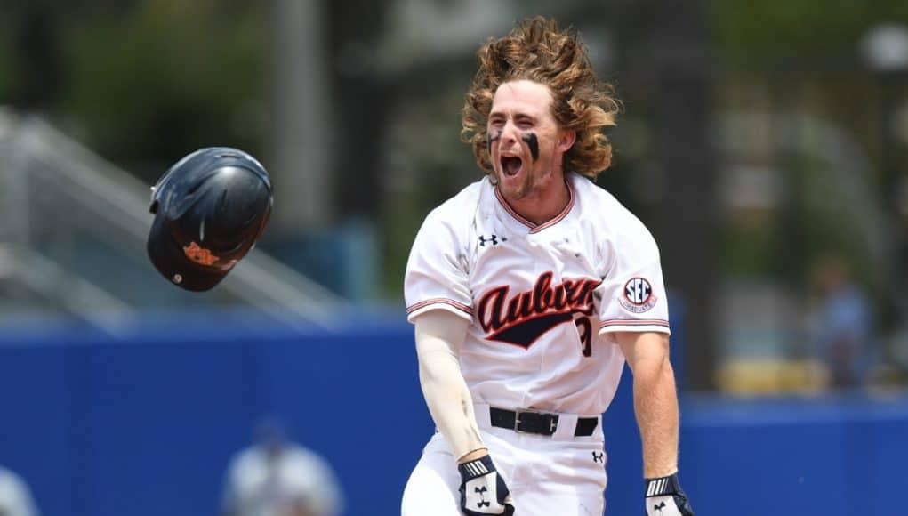 University of Auburn second baseman Luke Jarvis celebrates after his walk off single to beat the Florida Gators in the Gainesville Super Regional- Florida Gators baseball-1280x851