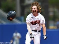 University of Auburn second baseman Luke Jarvis celebrates after his walk off single to beat the Florida Gators in the Gainesville Super Regional- Florida Gators baseball-1280x851