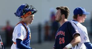 University of Florida catcher JJ Schwarz shakes hands with Auburn outfielder Conor Davis after the conclusion of the Gators and Tigers three-game series- Florida Gators baseball- 1280x853