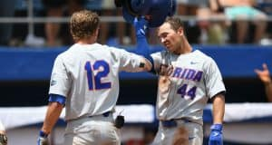 University of Florida outfielder Austin Langworthy is greeted by Blake Reese after Langworthy's game tying home run in the Gainesville Super Regional- Florida Gators baseball- 1280x853