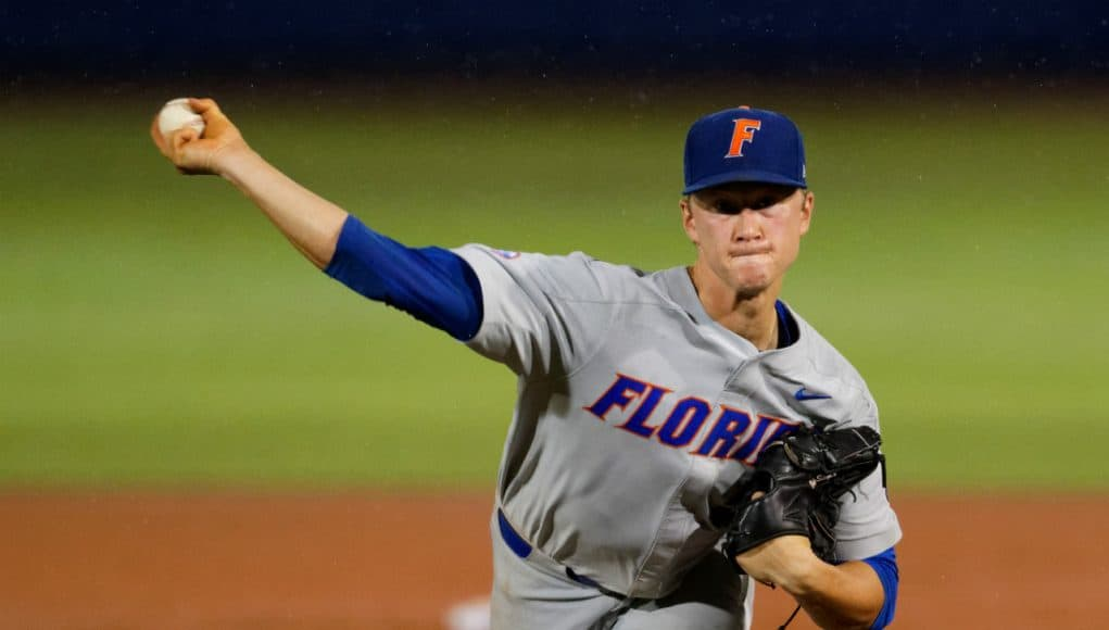 University of Florida pitcher Brady Singer throws against Jacksonville in the rain during the Gainesville Regional- Florida Gators baseball- 1280x853