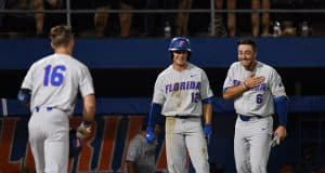 University of Florida third baseman Jonathan India and Blake Reese meet Wil Dalton at the plate after his home run against Jacksonville in the Gainesville Regional- Florida Gators baseball- 1280x853
