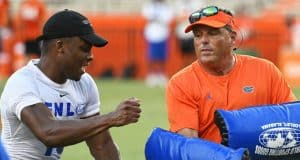 University of Florida defensive coordinator Todd Grantham goes through pass rushing drills with campers during Friday Night Lights- Florida Gators football- 1280x853
