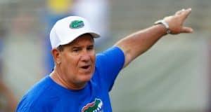 University of Florida defensive line coach Sal Sunseri taking campers through drills during Friday Night Lights- Florida Gators football- 1280x853