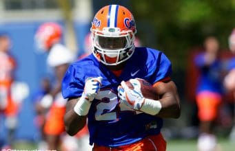University of Florida freshman Iverson Clement carries the ball during a running backs drill in spring practice- Florida Gators football- 1280x854