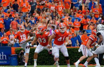 University of Florida long snapper Ryan Farr (41) runs down the field as Johnny Townsend punts during a win over Vanderbilt in 2017- Florida Gators football- 1280x852