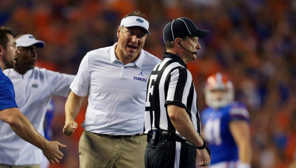 Florida Gators head coach Dan Mullen talks to the referee during the Kentucky game - 1280x853