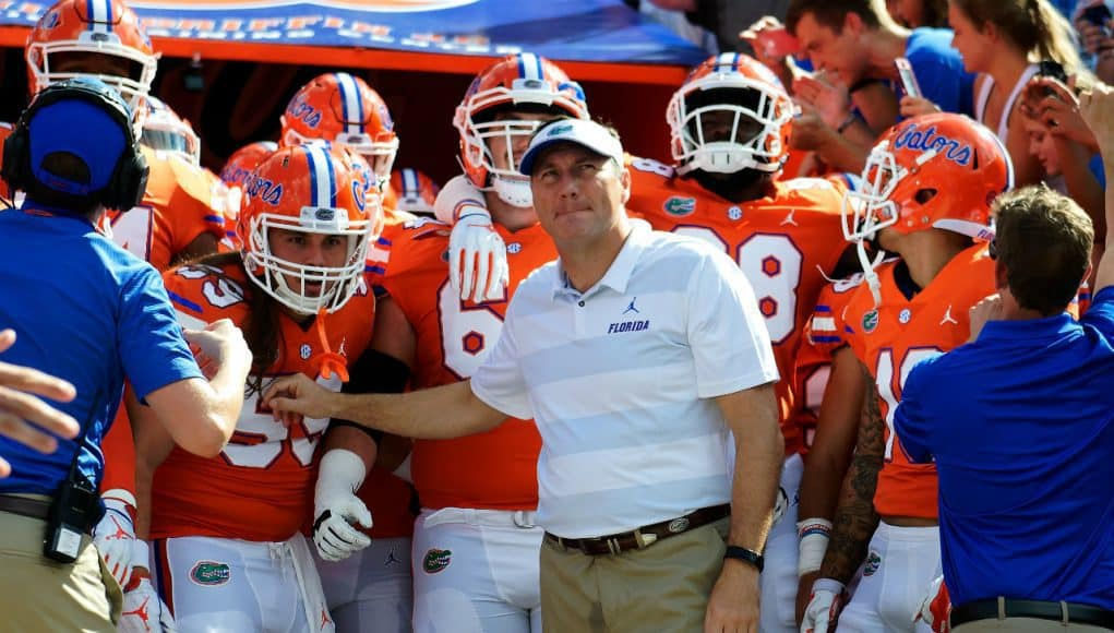 University of Florida head coach Dan Mullen waits with his team before they take the field for a game against Colorado State- Florida Gators football- 1280x852