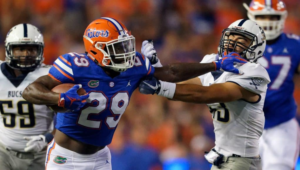 University of Florida running back Dameon Pierce stiff arms a defender during the Florida Gators 53-6 win over Charleston Southern- Florida Gators football- 1280x853