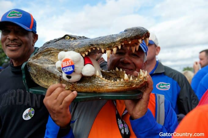 Florida Gators fans hold a Gator head before Gator Walk-1280x852