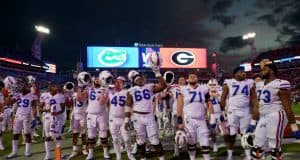 University of Florida football players stand on the field and sing the alma mater after a 36-17 loss to the Georgia Bulldogs- Florida Gators football- 1280x852