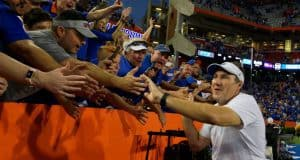 University of Florida head coach Dan Mullen does a victory lap around Ben Hill Griffin Stadium after the Florida Gators win over LSU- Florida Gators football- 1280x852