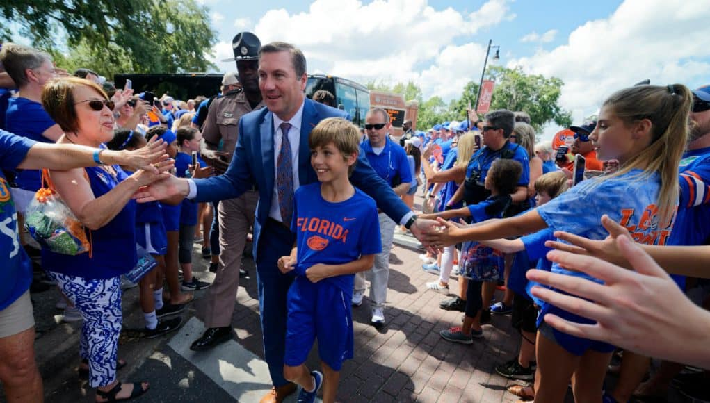University of Florida head football coach Dan Mullen walks into Ben Hill Griffin Stadium with his son before the Gators host LSU- Florida Gators football- 1280x852