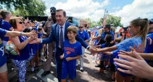 University of Florida head football coach Dan Mullen walks into Ben Hill Griffin Stadium with his son before the Gators host LSU- Florida Gators football- 1280x852